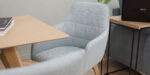 detail modern dining chair with armrest in mint upholstery and oak legs