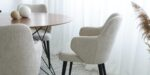 dining chair in grey upholstery and black legs