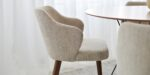 dining chair in beige upholstery and walnut