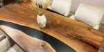 dining table with walnut and black epoxy