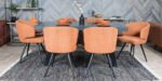 dining set black oak table and orange chairs